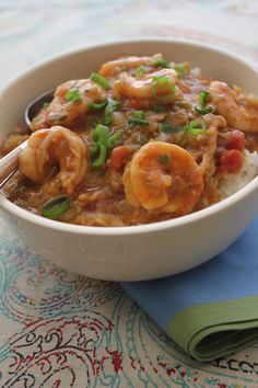 """Though it may sound very fancy, étouffée is French for """"smothered"""" -- and generally refers to a sort of stew in which the main ingredient is cooked in a rich gravy and served over white rice. Here, shrimp take the center role. Creole Recipes, Cajun Recipes, Shrimp Recipes, Cooking Recipes, Easy Recipes, Etouffee Recipe, Crawfish Etouffee, Louisiana Recipes, Southern Recipes"""