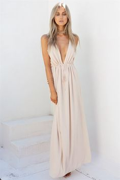Channel your inner goddess with the Athena Maxi! Made from a cream fabric with a textured sheer overlay, it is a full length maxi design with tank sleeves, deep V neckline and drawstring at waist. Designed to be flowy with waist tie to draw in at waist. Complete the look with gold jewellery and neutral strappy flats. Exclusively designed by Sabo Skirt.