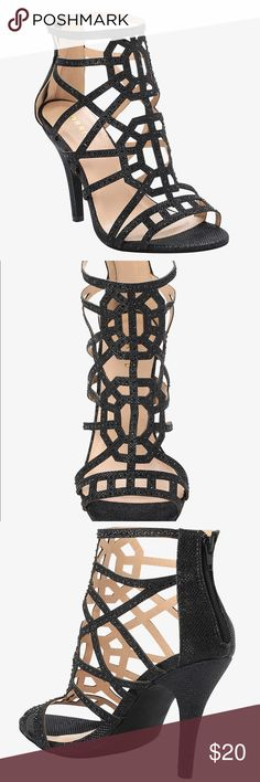 """Torrid Cage Stone heels in black 7 *wide* New with sticker tag, no box. Selling for a friend. Bundle with the second pair I'm listing and save on shipping! Size 7. Signature """"wide width"""" fit for larger feet. Classic strappy design. Sold out online.  """"This is one pair of black heels that is a must for the holiday season. Perfect fit for your party look, this savvy shoe comes with cage detail and gemstones that create the right touch of classy pizzazz."""" torrid Shoes Heels"""