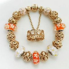 Gold Pandora bracelet.