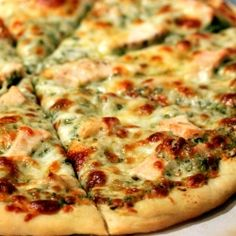 The perfect pizza crust with chicken, roasted garlic, and pesto!  Thinking about making your own pizza dough?  This is the recipe you need!