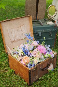 Vintage Tea Party Bridal Shower | Flowers in Vintage Suitcase Wedding Decor | Simply Jessica Marie and Simply Put Vintage Rentals styling featured on Wedding Chicks