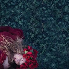 """""""Dreamy red"""" © Natascha van Niekerk Red, in a sea of green… Conceptual portraiture, fine art photography as decor"""