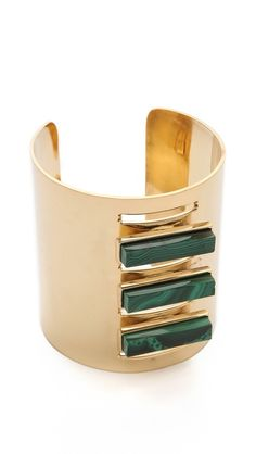 Kelly Wearstler, Bands of faceted malachite and slim cutouts look graphic and modern on a wide Kelly Wearstler cuff. 24k gold plate. Made in the USA. $395