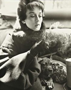 Richard Avedon - Dorian Leigh in Dior Coat, Avenue Montaigne, Paris, August 1949 image 2 of 3 next previous- Look at the CUTE dog! Portraits, Portrait Photographers, Richard Avedon Photography, Dorian Leigh, America Images, Vintage Dog, Summer Days, Fashion Photography, White Photography
