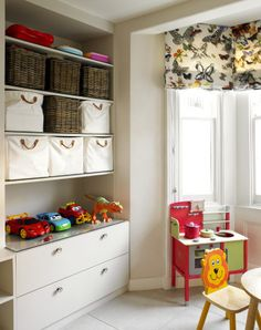 Bayswater Family Home bespoke cabinetry with basket storage - Print  fabric roman shades - Oversized drawers for toys - Large shelves to fit baskets - Plexiglas surface to display items and avoid scratching surface