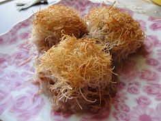 Kataifi -- shredded filo dough with walnuts drenched in a honey cinnamon syrup -- super Greek and super good