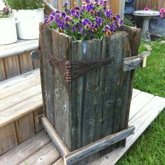 Barn board flower pot stand.                                                                                                                                                      More
