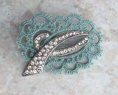Love this Idea..... must get out my grandmother's old rhinestone pin