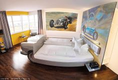 On the road: The Tower Suite inside the V8 Hotel, where guests sleep in this car-themed bed