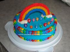 Homemade Somewhere over the Rainbow Cake: My daughter decided she wanted a Somewhere Over the Rainbow third birthday party, but didn't want anything to do with Dorothy or the Wizard of Oz, so that