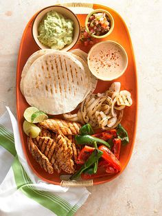 a tray of fiesta ~Grilled Chicken-Finger Fajitas with Peppers & Onions