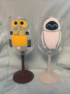 Wall-E and EVE set inspired by Disney and Pixars Wall-E vinyl set  This wine glass is made with a glittered stem sealed with a thick glaze. The