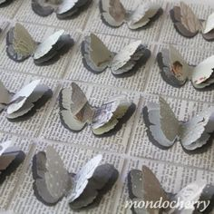 Butterflies punched from old books and sewed onto make a beautiful collage