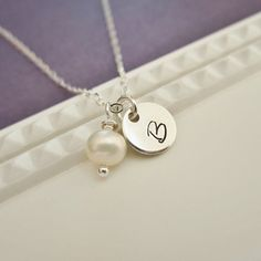 Personalized initial necklace with pearl, single initial, custom letter, sterling silver monogram necklace, freshwater pearl. $26.00, via Etsy.