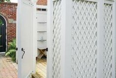 Inlaid lattice was used to customize the exterior of this outdoor shower.