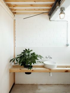 Floating wood vanity + plant stand #indoorplants #interiordesign #architecture…