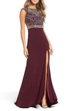 Free shipping and returns on Mac Duggal Open Back Beaded Gown at Nordstrom.com. A sleek gown turns heads with Art Deco-inspired beading over a fitted bodice that cuts away at the sides and back. Another alluring detail: a front slit showing a long length of leg.