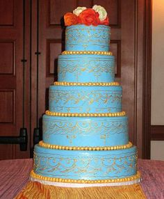 Image from http://www.thefrenchgourmet.com/products/unusual-wedding-cakes/big/42-henna-design.jpg.