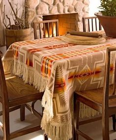 Ditch the table cloth in favor of a throw or blanket for instant autumn flair.