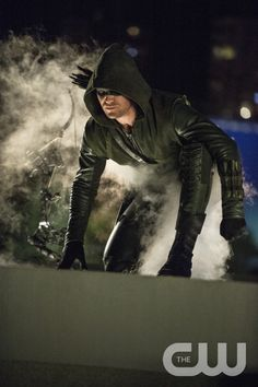 """Arrow -- """"The Calm"""" -- Image AR301b_0322b -- Pictured: Stephen Amell as The Arrow -- Photo: Cate Cameron/The CW -- © 2014 The CW Network, LLC. All Rights Reserved.pn"""