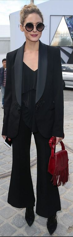 Who made  Olivia Palermo's black cut out boots, pleated top, blazer, and pants?