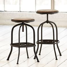 The iconic industrial design of our Allen Stool is based on a drafting stool from the early 1900s. And like the original, ours has small imperfections that add to its vintage charm. The backless design tucks beneath a counter, adjusts to bar height, or makes a great choice as a worktable perch. Its weathered hardwood seat swivels and adjusts in height by a screw mechanism underneath.Allen Stool features:   * Sturdy metal frame  * Mango wood seat  * No assembly required