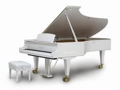 A Bosendorfer Imperial...that too in white!!! I'm out of words