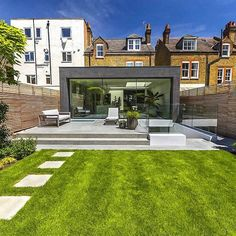 Stunning Contemporary Garden, A generous polished concrete patio continues from inside to outside and steps down to sawn sandstone paving stones Back Garden Landscaping, Modern Landscaping, Backyard Patio, House Extension Plans, House Extension Design, Concrete Patios, Contemporary Garden Design, Modern Landscape Design, Back Garden Design