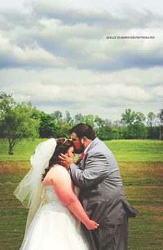#ashleyscarbroughphotography #photography #knoxville #tennessee #wedding #summer #bride #groom #kiss #stormclouds