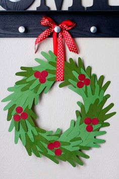 Drawing around hands and then cutting out the shapes gives you the basis for this paper wreath.