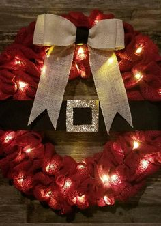 Items similar to Lighted red santa belt burlap wreath! Order yours today! on Etsy Christmas Wreaths With Lights, Lighted Wreaths, Burlap Christmas, Holiday Wreaths, Christmas Decorations, Christmas Ornaments, Christmas Décor, Wreath Crafts, Diy Wreath