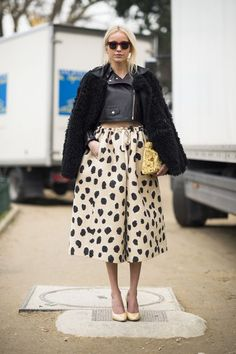 Street Style: An exercise in proportional play and contrasting style personalities with an edgy jacket and perfectly sweet skirt at Paris Fashion Week Fall 2013. Via Fabsugar