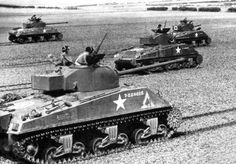 """Shermans from 1st Armoured Division in Normandy. In the foreground a tank version """"Firefly""""."""