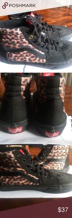 Black and leopard Vans👟👞 Size 7.5 in women/ 6 in men black and leopard vans. They're in great condition. Not heavily worn. Vans Shoes Sneakers