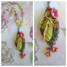 Polymer leaves and flowers are glued onto a filigree piece .. at the bottom of the focal are glass flowers and pearls and the chain is made with glass beads, crystals and pearls, brass chain and clasp .. Designed by Jann Tague .. Clever Designs .. http://www.pinterest.com/janntague/clever-design