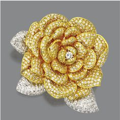 DIAMOND ROSE BROOCH The rose in full bloom set in the center with a round diamond, the petals and leaves pavé-set with numerous small round diamonds weighing a total of approximately carats, mounted in yellow and white gold. Jewelry Art, Antique Jewelry, Vintage Jewelry, Fine Jewelry, Jewelry Design, Fashion Jewelry, Antique Brooches, Yellow Jewelry, Diamond Flower