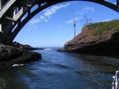 Depoe Bay Bridge, shoot the gap under the bridge to get out of the smallest bay in the world, 4acres; Central Oregon coast ten miles north of Newport, Or.  great fishing!