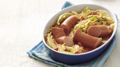 In this old-country specialty, cabbage is served over sliced smoked sausage with flavorful tomatoes, herbs and pepper.