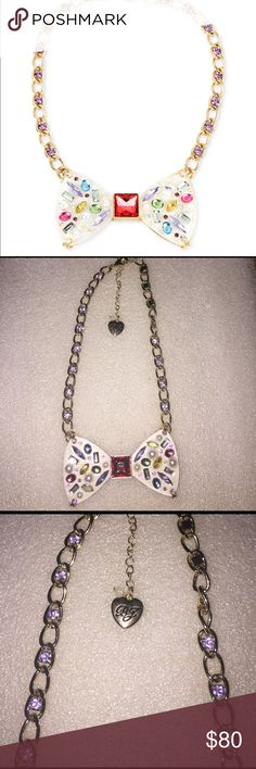 Betsey Johnson necklace Selling to buy betsey pieces I need. The necklace is gold with medium sizes rhinestones along the sides. The center piece is of a large bow with rhinestones. The rhinestones are of various sizes and shapes and multi colored. NWT Betsey Johnson Jewelry Necklaces