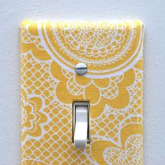 I have thought of this idea years ago. I thoughtI of covering my room's light plate with fabric using a strong adhesive tape just to add an accent to my plain white wall. So I got excited seeing this idea at Etsy.com thinking if I would order a set with different fabric styles or I would just make my own. ^^    Photo from Ryan Marie, the shop owner.
