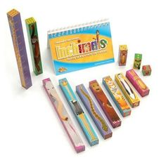 """Inchimals is a set of 12 beautifully crafted, and thoughtfully designed wooden blocks which measure from 1"""" in height (the tiny ladybug) to the 12 """" tall towering giraffe. Children learn math and have fun at the same time by combining the Inchimal blocks with the 100 write-on and wipe-off math puzzles. Kids explore counting, number value and recognition, scale, fine motor skills, language, and imagination."""