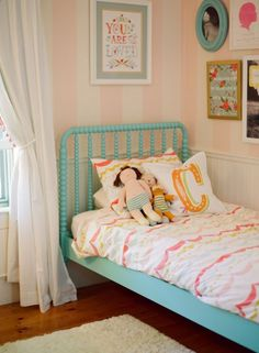 Dark pink/light pink stripes on the top half of the wall with white wainscotting on the bottom half of the wall