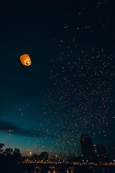 Floating lanterns filling the night sky