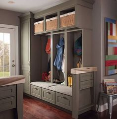 entry or mudroom? Separators can be used if space is deep enough,  maybe put a roll up curtain so if want to hide the mess of hooks, etc.