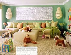 Fun playroom/family room idea. Love the hanging lights, the U sectional and the cozy carpet.