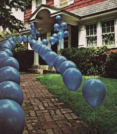 golf tee's with balloons tied on. if tent in the backyard to lead quests through the fence opening.