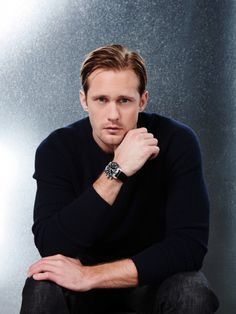 Alexander Skarsgard. Ok, change the hair to brown and narrow the nose just a bit and I swear he looks a lot like my hubby! Grrr!
