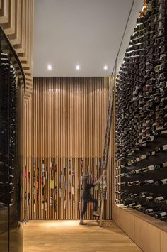 Mistral wine store in Sao Paulo, Brazil. The Mistral Wine and Champagne Bar and shop in São Paulo, Brazil, was designed by Studio Arthur Casas and features 100 square meters of elegantly curved space comprising storage, a shop floor, cellar and wine tasting area, each accented by carefully balanced exposed wine bottles.