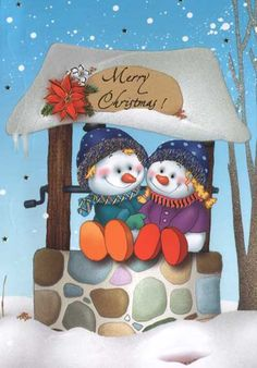 This snowman couple wishes you - and each other - a merry Christmas.